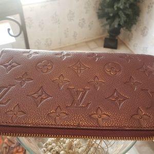 Louis Vuitton  Zip Wallet, Amethyst  SP 2172